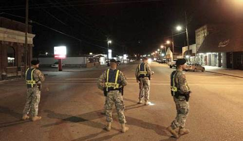 U.S. Army soldiers from Fort Rucker patrolling downtown Samson, Alabama, after the shooting spree on Tuesday. (Mark Wallheiser/Reuters)